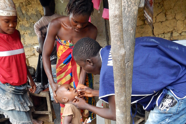 A young girl gets vitamin A supplement during a measles and polio vaccination drive. (Photo/CDC)